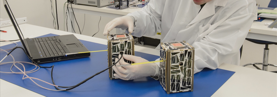 ADAC thumbnail showing man testing CubeSat